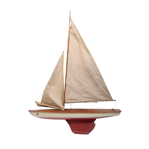 215 - AN EARLY POND YACHT BY 'BOATS' the white painted hull with a single mast, the hull 84cm long and the...