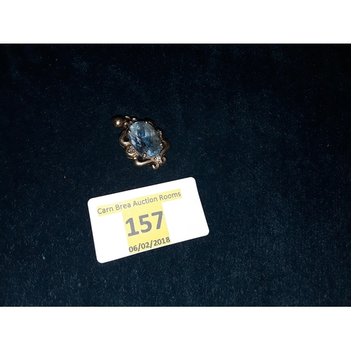 157 - 9ct gold and pale sapphire pendant...