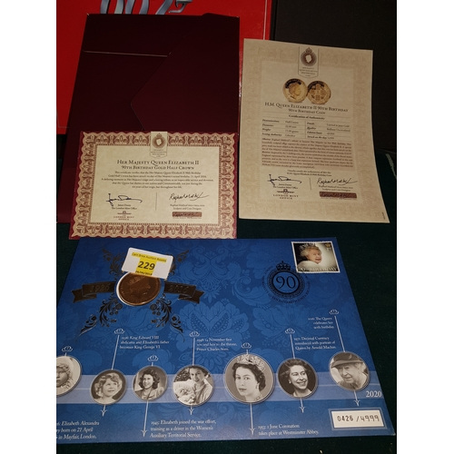 229 - Queens 90th mint coin stamp set...