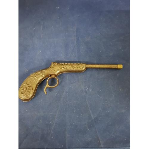 66 - Vintage c1920 cast iron toy gun  (fires  sucker darts not included)...