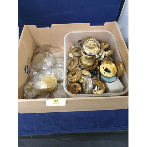 41 - Box of watch parts & glass faces...