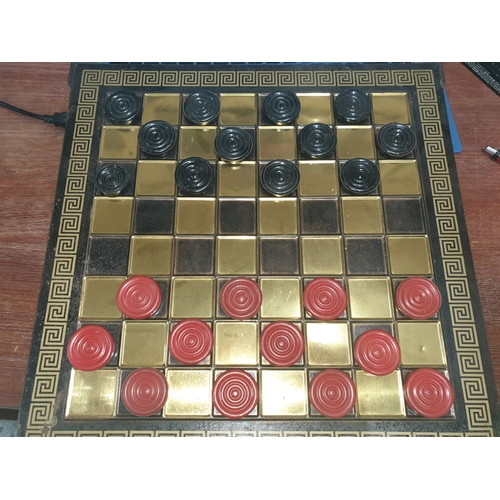 16 - Vintage tin draughts on...