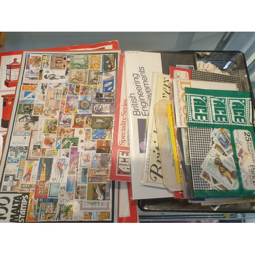 32 - Tin & sheet of stamps...