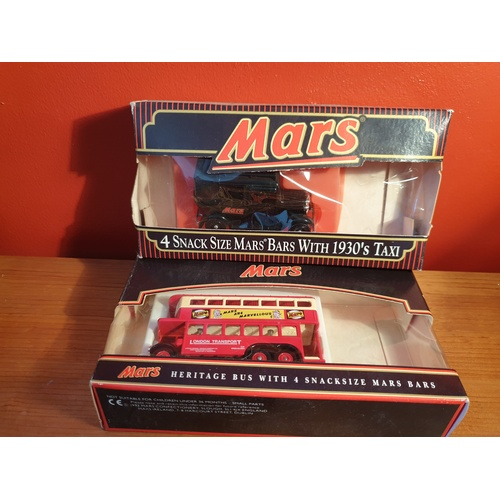 608 - Two mars promtional vehicles boxed...