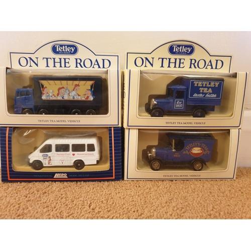 425 - 4 x Tetley vehicles...