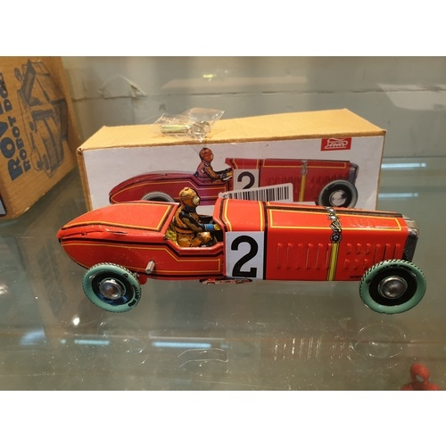 11 - Tinplate clockwork car boxed...
