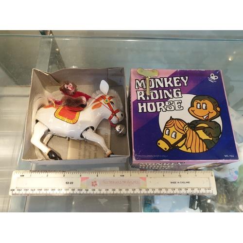 19 - Tinplate Clockwork Monkey riding horse...