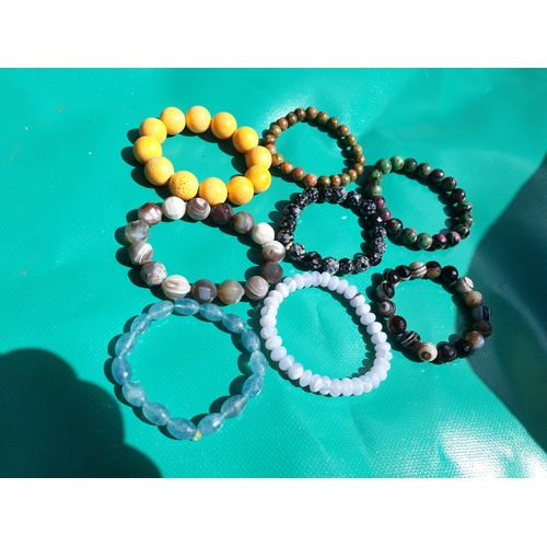 28 - Selection of polished stone bracelets...