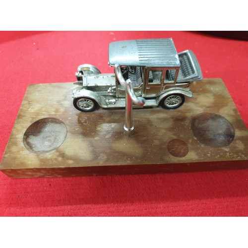18 - wooden Twin pipe rack with Matchbox Rolls Royce...