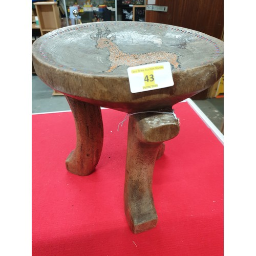 43 - African carved stool embossed with beads...