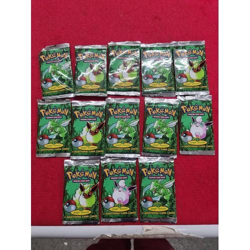 124 - 13 unopened packs Pokemon...