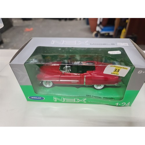 33 - Welly Nex 1:24 car...