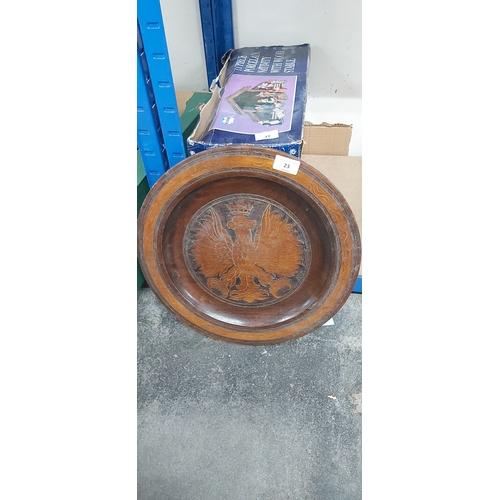 23 - Large carved wood eagle platter...