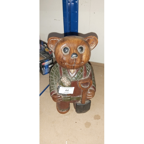 44 - carved wood ted...