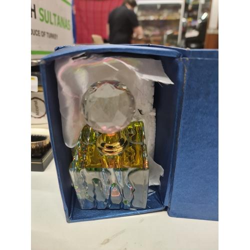 10 - Boxed perfume bottle