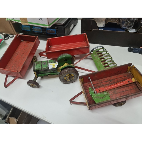 35 - Mettoy tinplate tractor & trailers