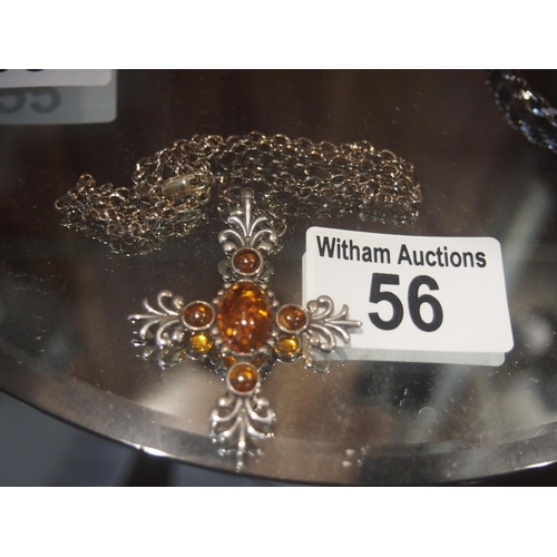56 - Amber and silver cross and chain necklace...