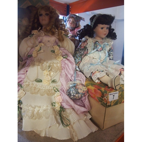 7 - Five china faced collectable dolls with boxes...