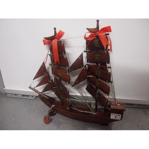 1 - A treen Chinese Junk boat...