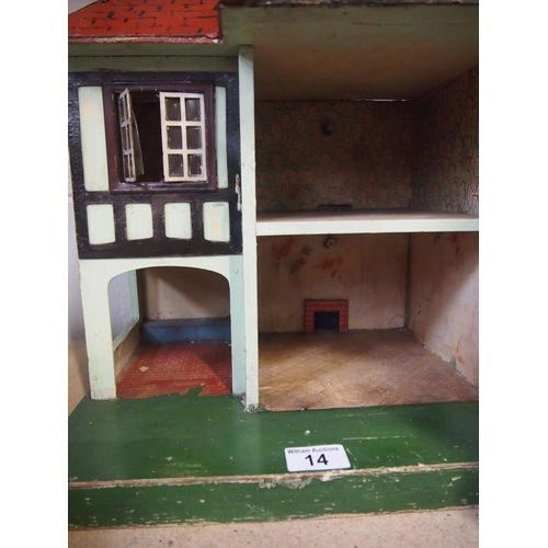 14 - Tudor style 'Triang Toys' small doll's house with metal window...