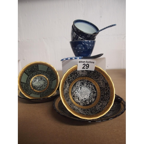 29 - Two decorative Japanese cup and saucers plus three Japanese ceramic serving bowls with spoons...