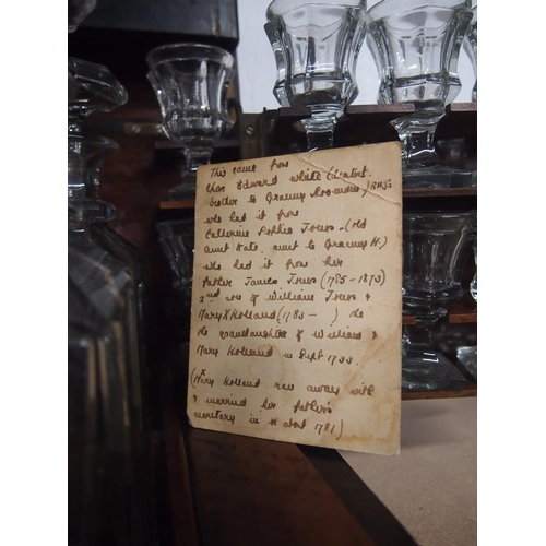 46 - Early antique tantalus with four decanters and sixteen stemmed glasses in ebonised box...