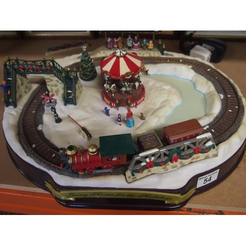 54 - Decorative electric train set 'Going home for the holidays'...