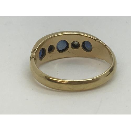98 - 18ct yellow gold sapphire and diamond five-stone ring. Estimated total diamond weight 0.8ct. Hallmar...