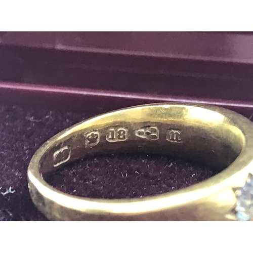 99 - Victorian 18ct yellow gold ring with three diamonds. Each round cut diamond is set into a star desig...
