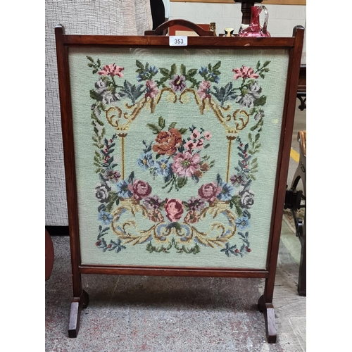 Floral embroidered antique fire guard.