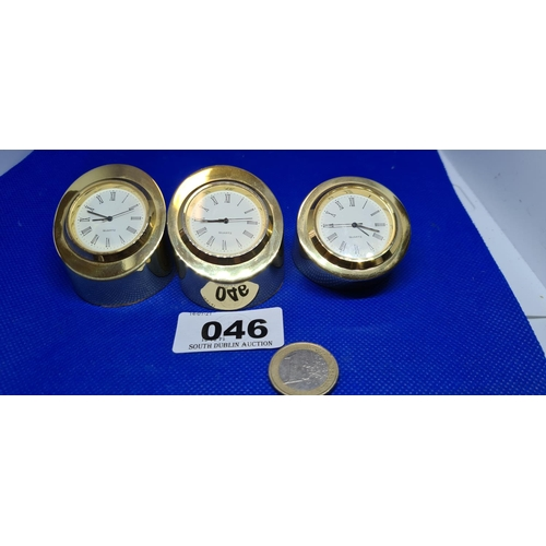 46 - 3 New small very heavy inclining brass desk clocks. Retail on these is €63 each they have a combined...
