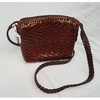 Double-strapped cross-body bag in brown-red, patent genuine leather.