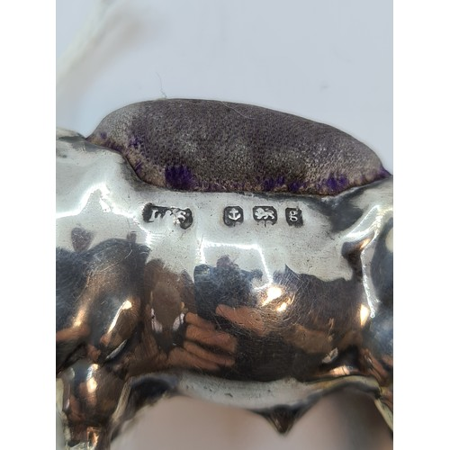 37 - Love this. Fabulous antique Sterling Silver bull pin cushion.