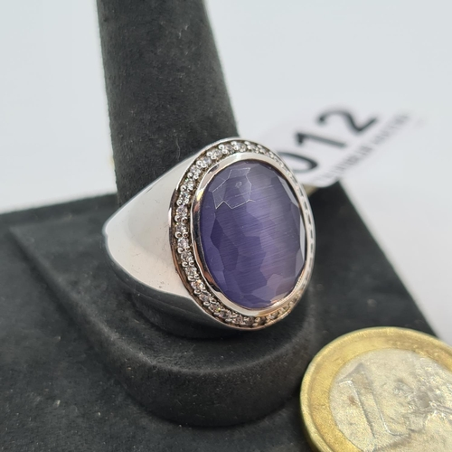 12 - NEW TI-SENTO Italian designer ring with a cut purple stone, rhodium plated priced at €160 size O