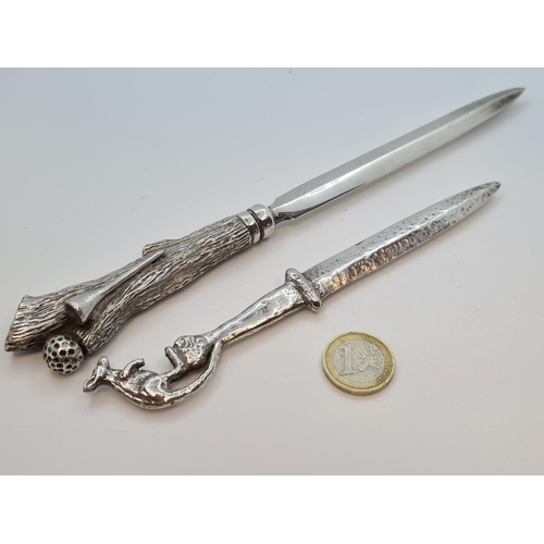 28 - Two unusual letter openers.