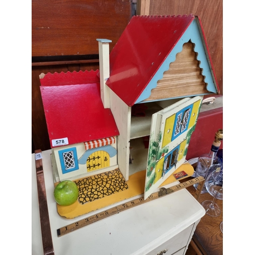 A Vintage Dolls House with Red Painted Roof.