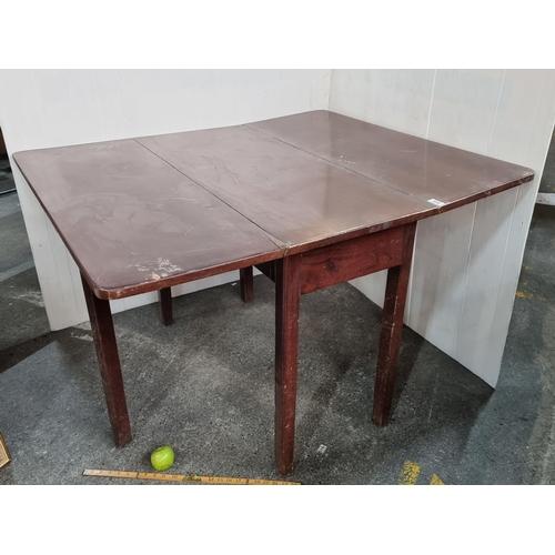Georgian Double drop-leaf table.Good quality heavy item. Mm: 74cm x 101cm x 45cm. (120cm when fully extended)