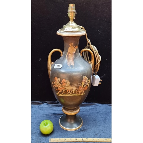 A Stunning large Neoclassical Lamp Base with images of a chariot, lamp made from a 19th century twn handled vase. Beautiful piece.