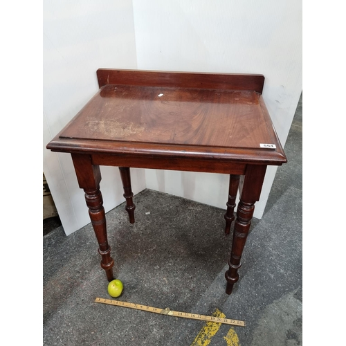 554 - A Victorian red mahogany Side Table .With gallery back and well turned legs.