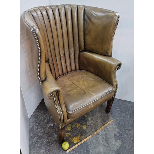 555 - Star Lot : Fabulous antique high winged backed porters style chair with fine grain green leather, St...