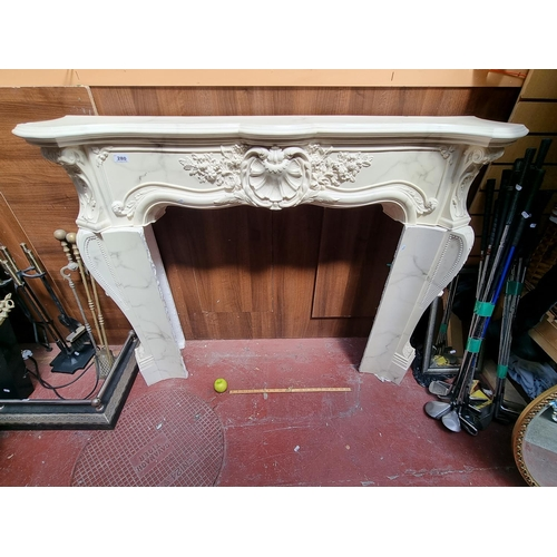 280 - A large marble-effect plaster fireplace. A stunning baroque-style, hand-painted fireplace with beaut...