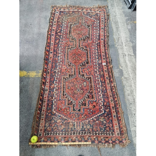 335 - A Lovely vintrage Hand Knotted Persian Rug, H195cm x W87cm.