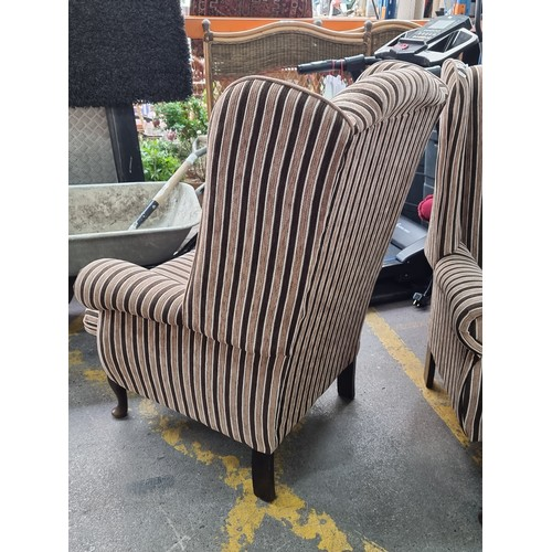 610 - Super pair of stripey large wing-back armchairs. Very comfortable.