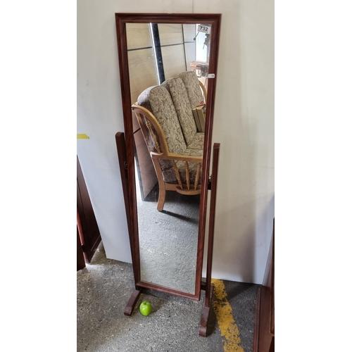 A full length wooden dressing swivel mirror.