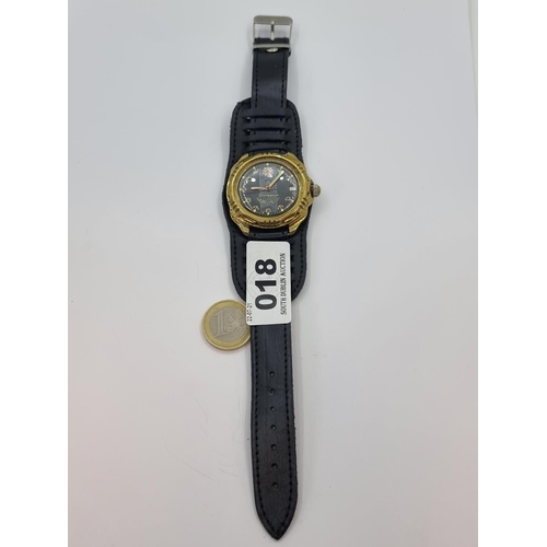 18 - A Soviet officers military mechanical watch with leather strap in good working order.
