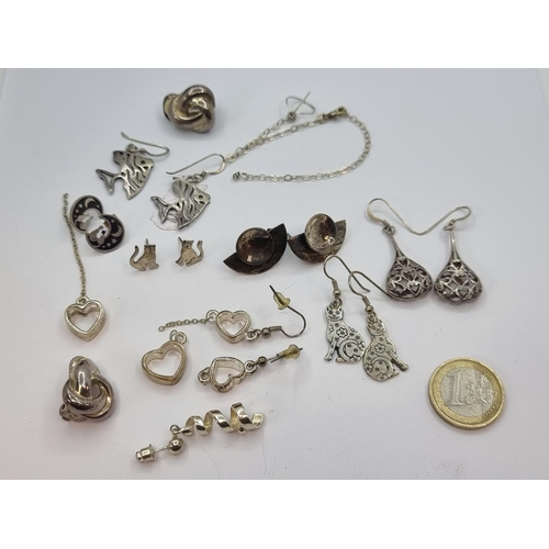 23 - A collection of seven pairs of sterling silver earrings, suitable for pierced ears, together with a ...