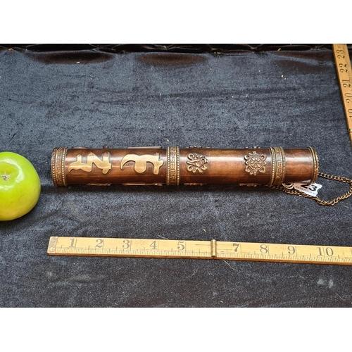 A copper scroll case of South Asian origin.