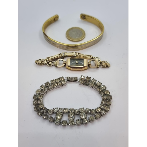 31 - Three jewellery items, one a bangle stamped 24k electro plated, together with a further diamante gra...