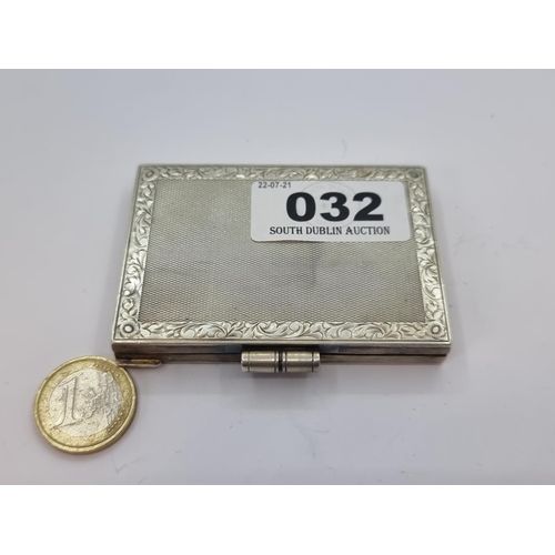 32 - A sterling silver engine turned design card case with the inscription inside 'Peggy'. Weight of silv...