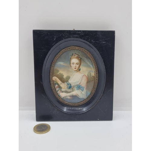 37 - A French handpainted miniature Georgian portrait of a lady, enclosed in a glazed, ebonized frame. A ...